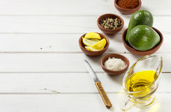 Avocado, and other ingredients for sauce guacamole on the table. Royalty Free Stock Photo