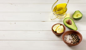 Avocado, and other ingredients for sauce guacamole on the table. Royalty Free Stock Images