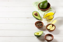 Avocado, and other ingredients for sauce guacamole on the table. Stock Photo