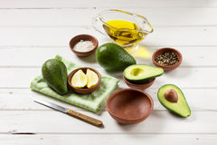 Avocado, and other ingredients for sauce guacamole on the table. Stock Photos