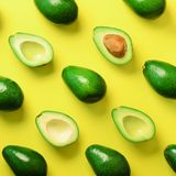 Avocado pattern on yellow background. Top view. Banner. Pop art design, creative summer food concept. Green avocadoes, minimal fla. T lay style. Square crop royalty free stock photos