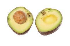 Avocado pear halves. Isolated against white royalty free stock photo
