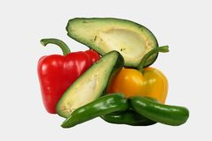 Avocado and pepper. Arrangement from fresh vegetables - sweet pepper and avocado Royalty Free Stock Photography
