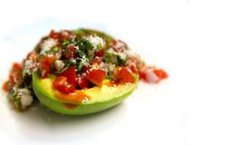 Avocado Pico De gallo salsa salad. With hot sauce sprinkled with cheese stock images