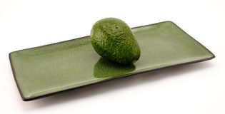 Avocado and Plate Stock Photos