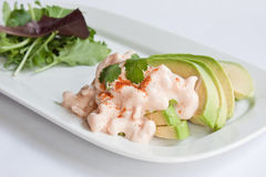 Avocado & Prawns. Slices of avocado topped with prawns in a marie rose sauce served with a green salad Stock Photos