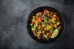 Avocado, quinoa, bean, corn and bell pepper salad. Top view stock photo