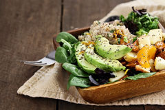 Avocado and Quinoa Salad with Chia Seed. Quinoa, avocado and apple salad. Perfect for the detox diet or just a healthy meal. Selective focus with extreme shallow stock photos