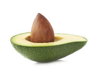 Avocado's half and pit isolated Royalty Free Stock Photography