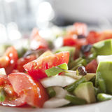 Avocado salad. Mexican avocado and tomato salad with onions and garnish Royalty Free Stock Photography