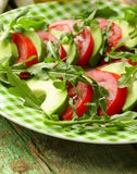 Avocado salad with arugula, tomato Royalty Free Stock Image