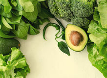 Avocado, salad, broccoli, spinach and pepper on white background. Healthy food concept with fresh assorted green Stock Image