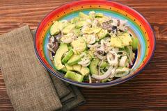 Avocado Salad with calamari and cucumber Stock Photos