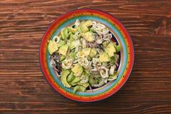 Avocado Salad with calamari and cucumber Stock Image