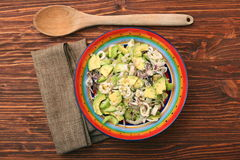 Avocado Salad with calamari and cucumber Royalty Free Stock Photo