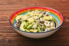 Avocado Salad with calamari and cucumber Stock Photography