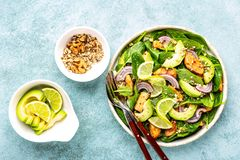 Avocado salad with chicken breast and spinach royalty free stock images