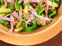 Avocado salad with ham and nuts Royalty Free Stock Image