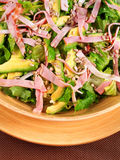 Avocado salad with ham and nuts Stock Photos