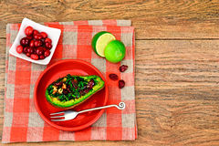 Avocado salad with herbs dill, parsley, cilantro, nuts and sun. Dried cranberries Studio Photo Stock Photo