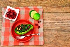 Avocado salad with herbs dill, parsley, cilantro, nuts and sun Stock Photo