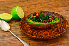 Avocado salad with herbs dill, parsley, cilantro, nuts and sun. Dried cranberries Studio Photo Stock Photos