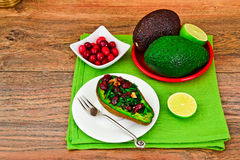 Avocado salad with herbs dill, parsley, cilantro, nuts. And sun-dried cranberries Studio Photo Stock Photo