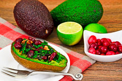 Avocado salad with herbs dill, parsley, cilantro, nuts. And sun-dried cranberries Studio Photo Royalty Free Stock Photo