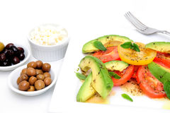 Avocado Salad And Olives Stock Photos