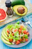 Avocado salad on a plate Stock Photo