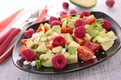 Avocado salad and raspberry Royalty Free Stock Photo