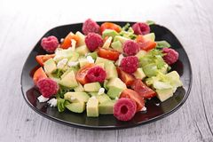 Avocado salad and raspberry Royalty Free Stock Photography