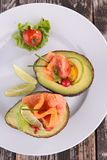 Avocado salad with salmon Stock Image