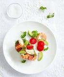 Avocado salad with shrimp. And quail eggs Royalty Free Stock Photo