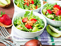 Avocado salad with strawberries and walnuts Royalty Free Stock Photography