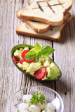 Avocado salad and toasted bread Royalty Free Stock Images