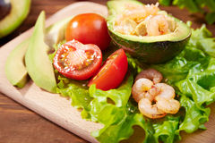 Avocado salad on a wooden background Royalty Free Stock Photo