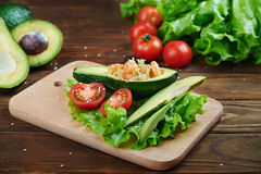 Avocado salad on a wooden background Stock Images