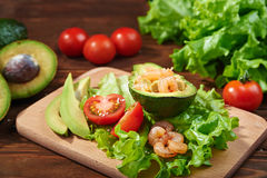Avocado salad on a wooden background Stock Image