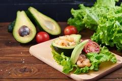 Avocado salad on a wooden background Stock Photos