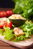 Avocado salad on a wooden background Royalty Free Stock Photography