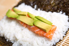 Avocado and salmon Stock Images