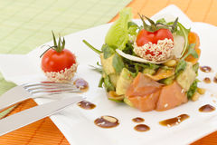 Avocado and salmon salad. With small tomato on top Royalty Free Stock Photos