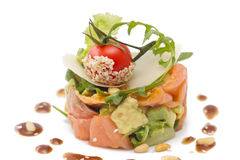 Avocado and salmon salad on white. Avocado and salmon salad with small tomato  on top, on white background Stock Photography