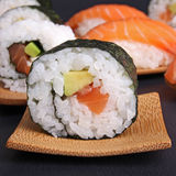 Avocado salmon sushi maki royalty free stock photography