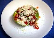 Avocado Salsa Salad with Cotija Cheese and Hot Sauce. Avocado Pico De Gallo Salsa Salad with hot sauce sprinkled with cheese royalty free stock photography