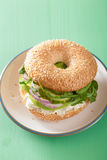 Avocado sandwich on bagel with cream cheese onion cucumber arugu Royalty Free Stock Images