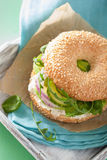 Avocado sandwich on bagel with cream cheese onion cucumber arugu Stock Photography