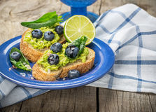 Avocado sandwich and blueberry on the wooden Stock Photo