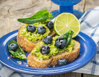 Avocado sandwich and blueberry on the wooden Stock Image